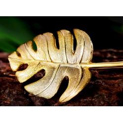 broches dorados mujer