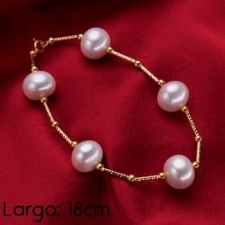 Brazalete de perlas blancas...